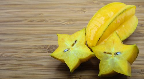 Carambola fruit or Star fruit on wood background